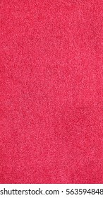 Red carpet texture useful as a background - vertical