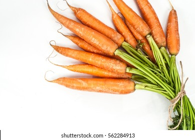 Red carrot on white background. Isolated carrot concept with copy space. Top view.