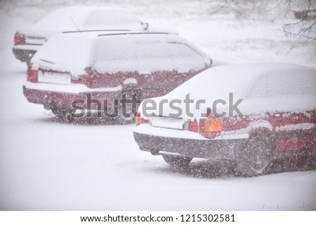 red-cars-under-snow-snowbank-450w-121530