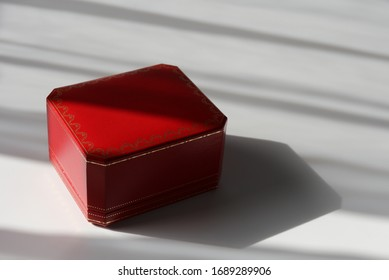 Red Cartier box on white background. Symbol of luxury style
