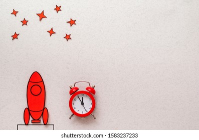 Red cartoon rocket on a launch pad