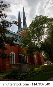 Red cathedral in Vaxjo in Smaland in Sweden with its distinguished neogothic design is used for prayers for Christians and church services as well as for music concerts that are held inside