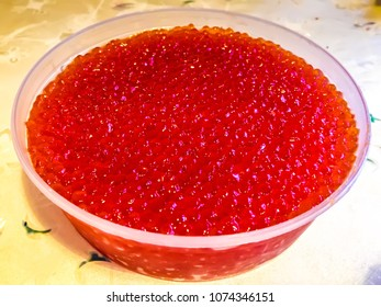Red Caviar fish delicacy. Delicious red seafood close up macro. Red caviar tasty and fresh. Expensive delicatessen salted and from sea. Salmon and trout caviar. Fresh and salted red caviar