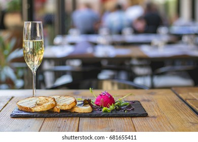 Red caviar with some toast and salad and a glass of champagne