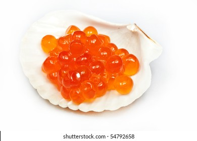 red caviar in a white cockleshell