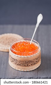Red caviar in the wood bowl
