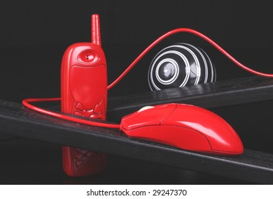 Red cell phone, red computer mouse.