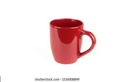 Red ceramic cup on a white background.