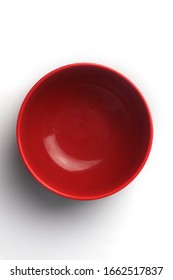 red ceramic empty bowl on white background