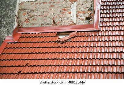 The red ceramic tiles on the old house. Marseilles profile roof tiles.