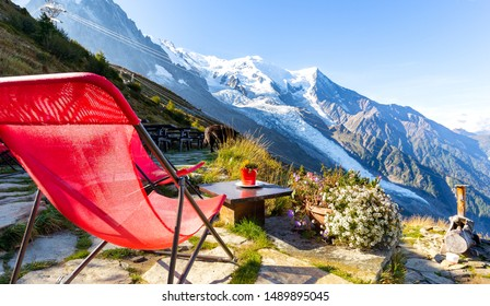 Red chair coffee table guest house Refuge du Plan de l'Aiguille restaurant bar, Mont Blanc beautiful mountain summit ridge  glacier landscape view point, French Alps travel, Europe tourism destination
