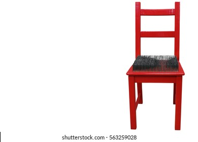 https://image.shutterstock.com/image-photo/red-chair-spikes-on-seat-260nw-563259028.jpg