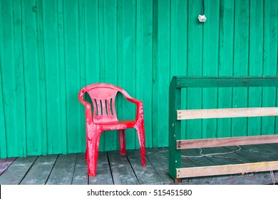 Red chair in  typical wood house  in Amazon River- Brazil.