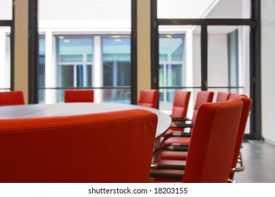 Red chairs in a board room