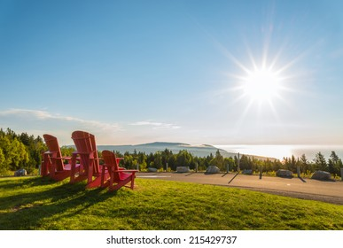 Red chairs from Butland lookoff  with a beautiful view of Fundy Shore scenery (Fundy National Park, New Brunswick, Canada)