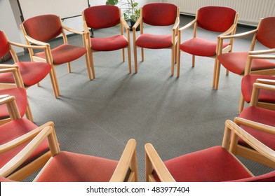 Red chairs in a circle