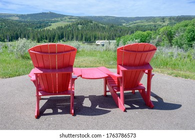 Red chairs at Fort Walsh National Historic Site in the Cypress Hills of Saskatchewan, Canada