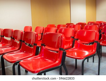 Red chairs in the meeting room for listening sessions.