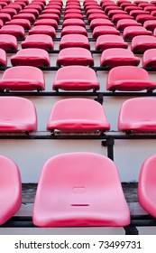 Red chairs on the miraculous. To watch a sporting event in the field.