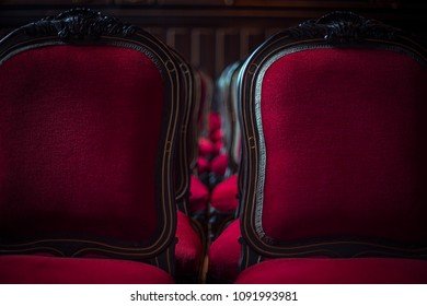Red chairs with other red chairs in the background. Recorded in Poland.