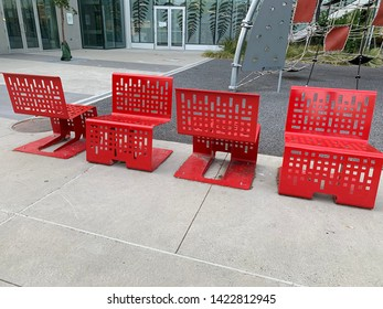 Red chairs outside of Newton Community Centre in Surrey BC Canada on June 9 2019