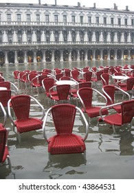 Red chairs in San Marco square - Venice
