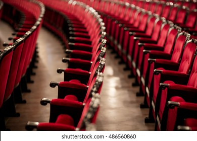 red chairs in theater interior with blurred details