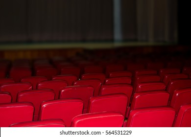 Red chairs from the tissue in an empty auditorium