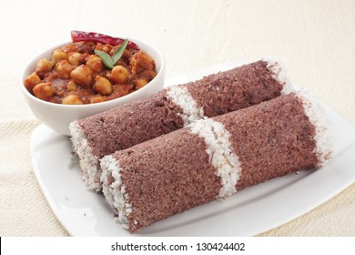 Red chamba Puttu with chickpeas curry.Puttu is na South Indian and Sri Lankan breakfast dish of steamed cylinders of ground rice layered with coconut.