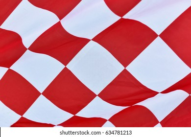 Red checkered flag texture for background.