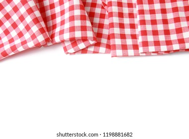 Red checkered folded picnic cloth border (napkin) isolated on a white background. Template for your product display montage.