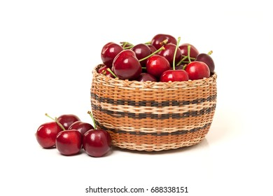 Red Cherries in a basket on white background