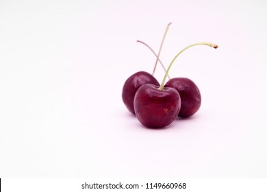 red cherry on white background and copy space