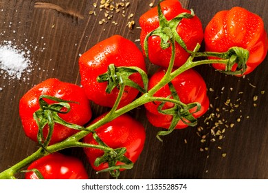 Red cherry tomates on brown cuting board