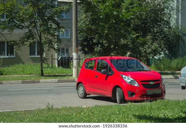 red-chevrolet-spark-car-parked-600w-1926