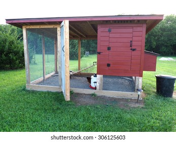 red chicken coop made of wood and screen