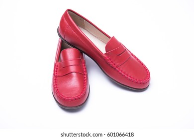 Red children's loafers on a white isolated background