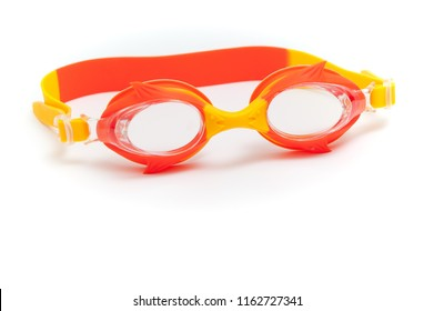 Red children's swimming goggles on a white background.