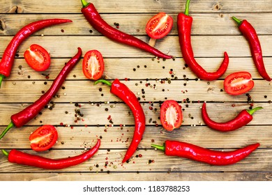 Red chili peper on wooden background/ Close up