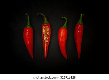 Red chili pepper on black background