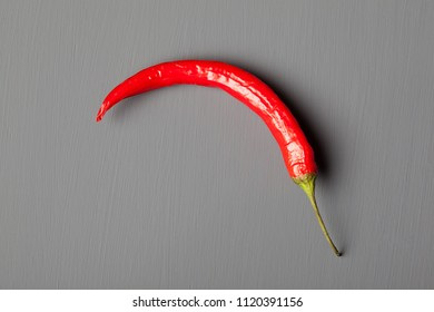 Red chili pepper on gray background