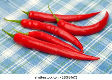 red chili pepperon blue tablecloth