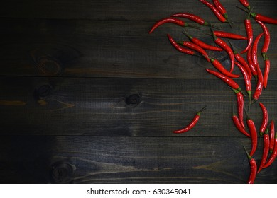 red chili peppers on the wooden texture desk . Appetizer concept