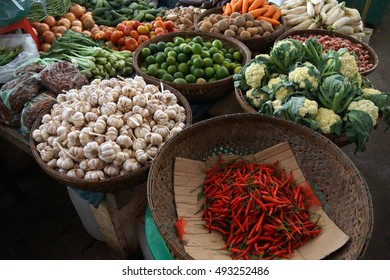 Red chili peppers and other vegetables for sale  at the Kratie central market,  Cambodia