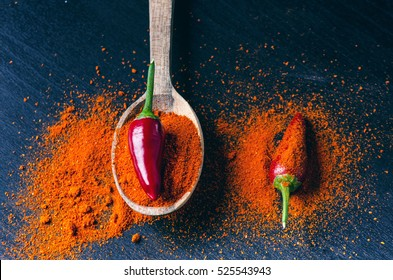 Red chili peppers, spicy on a wooden spoon. Chilly on a wooden spoon. Vegetable. Concept of hot food.