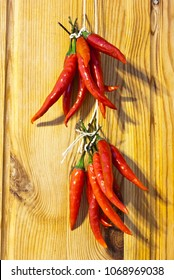 Red chilies drying on wall