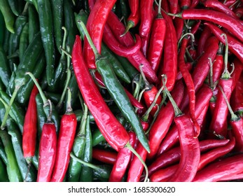 Red chilies and green chili stem for textured and background. Spicy red tiny fiery chili have Capsicum Oleoresin and full of Capsicin extract.