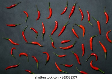 Red chilli on black background using fresh red., It has spicy., food concept., Top view