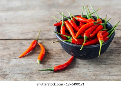 red chilli on wooden table