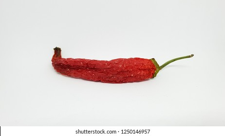 red chilli pepper isolated on white background closeup studio
